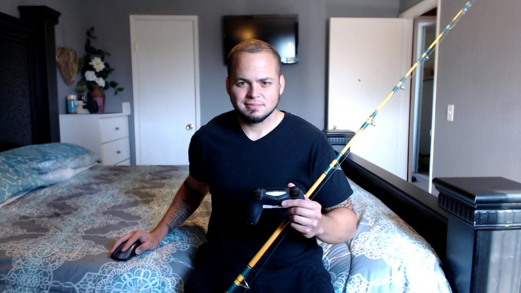 Picture of me with fishing rod and controller